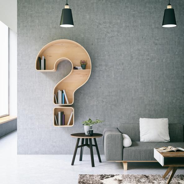 Minimalist living room with a question mark bookshelf